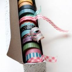 Upcycle a tin foil or wax paper box into a Washi Tape holder. It's the perfect size, has a roll and built in serrated strip.