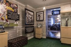"""Ally Coulter """"man-cave"""" hallway with sports memorabilia #allycoulter #mancaves #themedrooms"""