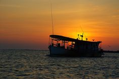 An East Galveston Bay oyster boat meets the fall sunrise as it heads out to harvest shellfish from the big bay on the Upper Texas Coast. By coastalangler ~ Larry Bozka. This photo was taken on October 26, 2005 using a Nikon D100.