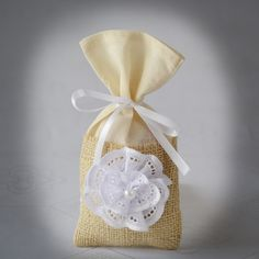 SET OF 50 Rustic Ivory Burlap and Linen Wedding Favor Bag or Gift Bag-Shabby Chik style. $139.00, via Etsy.