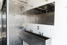 Porta Kleen's Mobile Shower Trailer features 16 private stalls, hot water, and sinks with mirrors. Dressing Area, Sinks, Divider, Shower, Mirror, Park, City, Water, Interior
