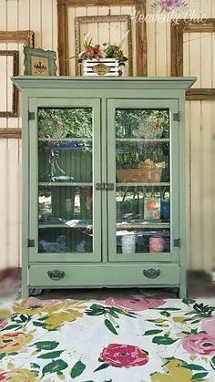 """We got this amazing solid wood hand made china cabinet/bookshelf. It was amazing craftsmanship but this baby needed more. Im totally head over heels, over the moon and more about the turn out. We """"drenched"""" (bc she was so dry) in the most amazing Green♡ makes you think happy thoughts! Shes butter smooth, new hardware color, new glass doors. I could keep going on and on but let me present """"Flowers of Eden""""  General Finishes """"Basil"""""""
