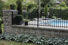 Field stone wall with Ornamental Iron Fence modern landscape
