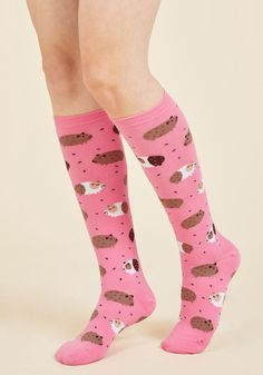 In the Pig Leagues Now Socks. You'll reach a new level of quirky style by donning these pink knee socks! #pink #modcloth