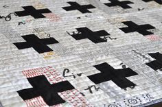 Maybe I can do something like this, but make the quilt look like a crossword puzzle.  +++ by red red completely red
