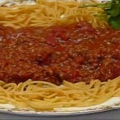 Here is how to make a family favorite--Spaghetti with Homemade Meat Sauce. It has loads of tomatoes and tomato sauces, and is flavored with oregano, sweet basil, and garlic powder. Accompanied by Asiago Cheese Bread and Italian greens, It makes a large, flavorful family meal!  - Easy Spaghetti with Homemade Meat Sauce