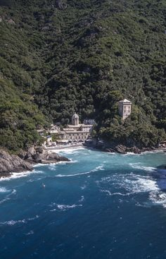 San Fruttuoso nestles among pine trees and olive groves between a little beach and the Capodimonte mountains, near Genoa. Our Landmark, Casa de Mar, is perched high above an abbey roof. It is only accessible by boat.