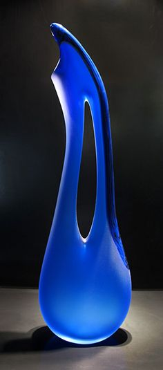 The Tall Blue Avelino glass sculpture contains a small element of opaque blue colored glass that runs up the right side as shown in the photo. Hand blown glass sculpture by Bernard Katz. Cobalt Glass, Cobalt Blue, Glass Vase, Blue Vases, Azul Indigo, Azul Real, Glas Art, Love Blue, Hand Blown Glass