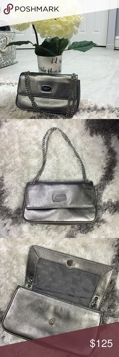 Silver Michael Kors Evening Bag Chain can be worn short and doubled or long and single. Gorgeous bag...pictures don't do it justice. Looks small but fits full size wallet with iPhone and makeup. Dimensions are 10.5 inches long...6 inches high and the strap drop is 8 inches when short and 15 inches when long! Michael Kors Bags Shoulder Bags