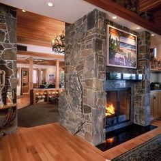 Double sided fireplace. I wonder if we could extend our living room and convert our double sided fireplace to look something like this!? @jacenbridges