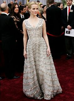 2006: REESE WITHERSPOON - Reese did something few actress can – pull off vintage on the red carpet. The pale beribboned and beaded '50's Dior dress made for a sweet look.