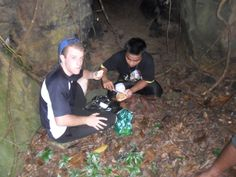 stopping for lunch outside a cave in the Uman jungle