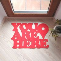 """Doormat """"You are here"""" with Google maps pin."""