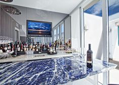 Beautiful Bar with Lapis Blue as the front bar and a White Onyx on the back bar..  Amazing!