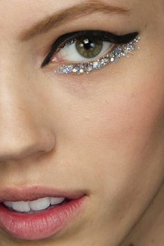 So, so cool.  BACKSTAGE BEAUTY: CHANEL COUTURE S/S 2014 | BLACK + GLITTER EYELINER