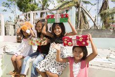 Children receive shoeboxes