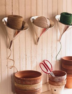 Twine Dispenser | Martha Stewart Living - Keep unruly balls of twine in line with big aluminum funnels, which serve as organizers and dispensers.