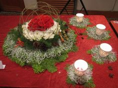 christmas flower designs | christmas table setting. The centerpiece is made of red roses with ...