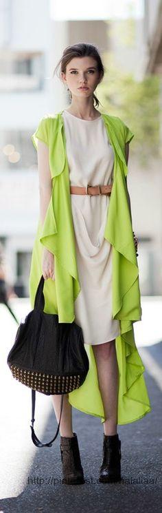 Street style - Love the long green vest.