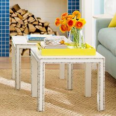 New Take on Tables. In place of a predictable coffee table, use two inexpensive side tables. Outline the edges with strips of nailhead trim for a high-end look.