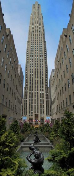 Rockefeller Center is a must-see attraction in New York! It is a complex of 19 commercial buildings covering 22 acres between and streets in New York City. After enjoying the view, be sure to visit Snafu! Rockefeller Center, Empire State Building, Shopping In New York, The Places Youll Go, Places To See, Skyline Von New York, New York City, Times Square, New York