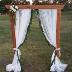 Timber Wedding Arbour With Fresh Garland