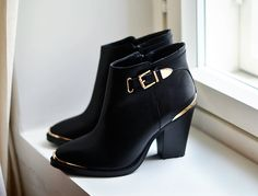 Black and gold leather boots from Steve Madden.