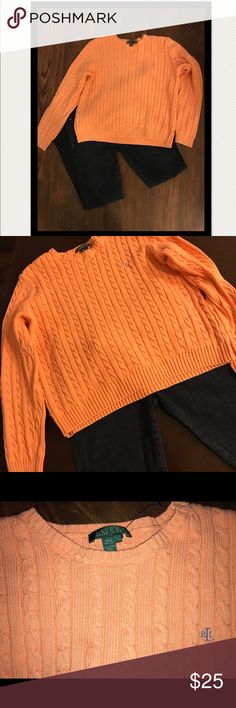 Like new Light orange/peach Ralph Lauren Sweater Classic Like new Ralph Lauren sweater for sale in size large. Very simple but can be paired with many items such as slacks, jeans, or even pearls. It is thicker which is a plus as it will keep someone warm this winter! It shows no wear and tear or staining! Please note that it does run smaller so it would also fit a person who usually wears a medium. Lauren Ralph Lauren Sweaters