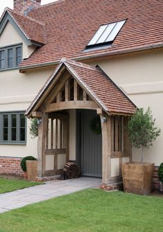 Image result for homes with green upvc windows and cream render