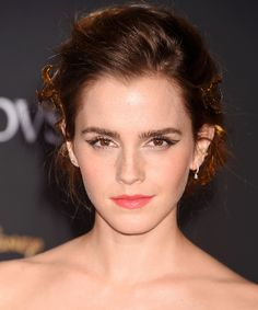 """Talk about putting the """"beauty"""" in Beauty and the Beast. Find out how you can recreate Emma Watson's gorgeous updo and negative space eyeliner."""
