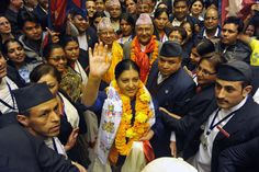 Newly elected Nepalese  president Bidhya Bhandari (C) greets supporters as she leaves parliament after her election win was announced in Kathmandu on October 28, 2015. Nepal's parliament elected lawmaker Bidhya Bhandari as the country's first female president October 28, after the adoption of a landmark constitution last month.    (PRAKASH MATHEMA/AFP/Getty Images)