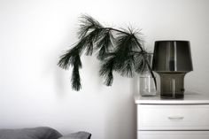Minimal holiday centerpiece - Single pine branch in a vase via RAW Design blog