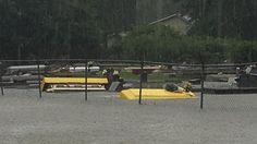Caskets were seen floating through Louisiana flood waters.