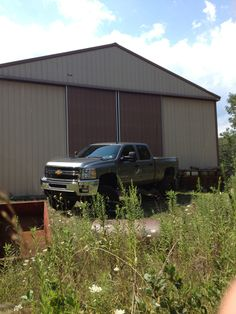 Lifted Chevy truck on the farm
