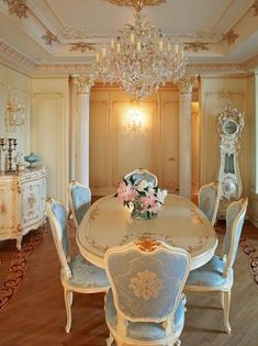 Dining room ~ white French provincial furniture with soft blue on the chairs