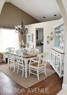Neutral dining room with a bit of blue. Dinner?