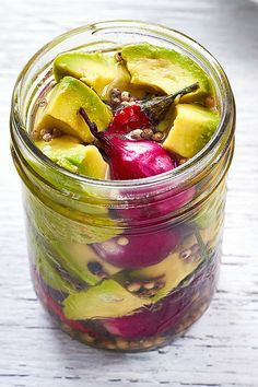 Pickled Avocados— One of the most delicious condiments you can have stashed in your fridge.