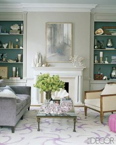 a fabulous beach house living room. The back wall of the shelving is perfect to display shells and other cream/silver tones items.