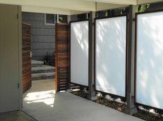 Panels framed in redwood & recycled redwood horizontal fence modern landscape