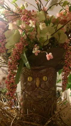 The owl came form a knick knack pattie wak store( junk ) with random flowers