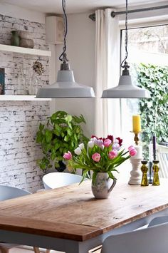 Exposed brick wall painted white aged, thick white floating shelves, fresh flowers, chunky wooden table and industrial ceiling pendants - design-h-ideas Kitchen Inspirations, Sweet Home, Decor, Decor Inspiration, Interior, White Floating Shelves, Industrial Ceiling Pendant, Rustic Decor, Home Decor