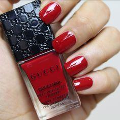 nails painted red with gucci nail polish