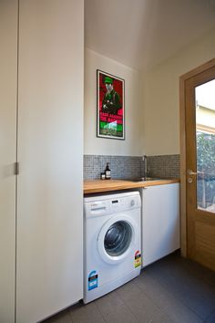 Maybe the laundry could be tucked against the wall like this to allow for a bigger bathroom where the outdoor toilet is (possibly a master bath)