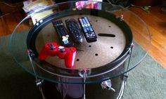 1 bass drum + 1 old cymbal + glass top = wicked coffee table.