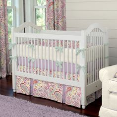 Watercolor Paisley Crib Bedding | Carousel Designs.  This stunning Watercolor Paisley collection features all of your favorite colors, from rich amethyst purple and soft seafoam green to vivacious coral. The adorable peek-a-boo skirt adds just the right amount of charm to this must-have crib bedding collection.