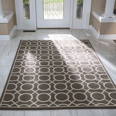 Make a great first impression with the right rug. Look for something wider than the doorway for comfortable greetings and departures.