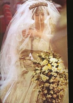 Lady Diana Spencer and her giant bouquet I remember her wedding .... One that on one would ever forget! Aline :)