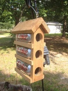 Soda pop cans bird houses.