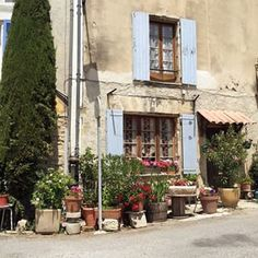 Blue shutters, flowers everywhere...loving everything about #Provence and trying hard not to take photos around every corner