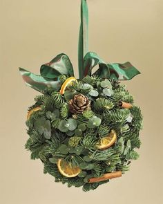 the Season: 10 Holiday Decor Ideas Evergreen Orange Kissing Ball from Williams SonomaEvergreen Orange Kissing Ball from Williams Sonoma Christmas Flowers, Christmas Balls, All Things Christmas, White Christmas, Christmas Holidays, Christmas Wreaths, Merry Christmas, Christmas Decorations, Christmas Ornaments